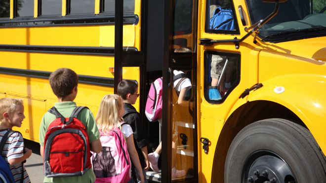 Elementary School Students Get on Bus