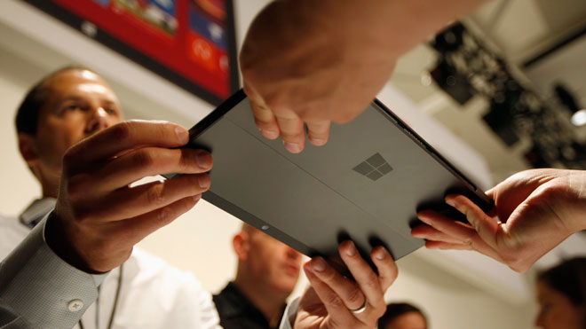 Microsoft Representative Holding Surface Tablet
