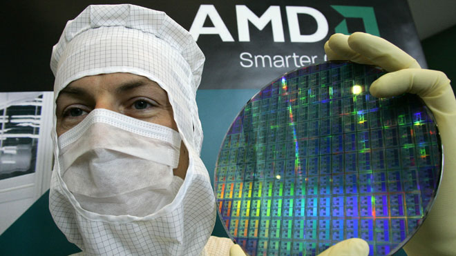 AMD Technician Poses With Chip Wafer