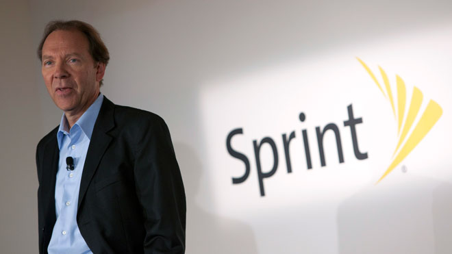 Sprint CEO Dan Hesse Next to Logo