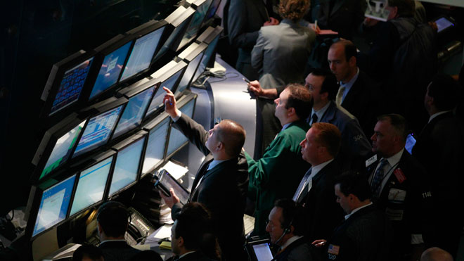NYSE Trader Pointing at Screen