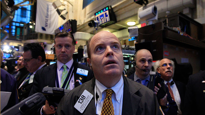 NYSE Trader Looking Up Anxiously