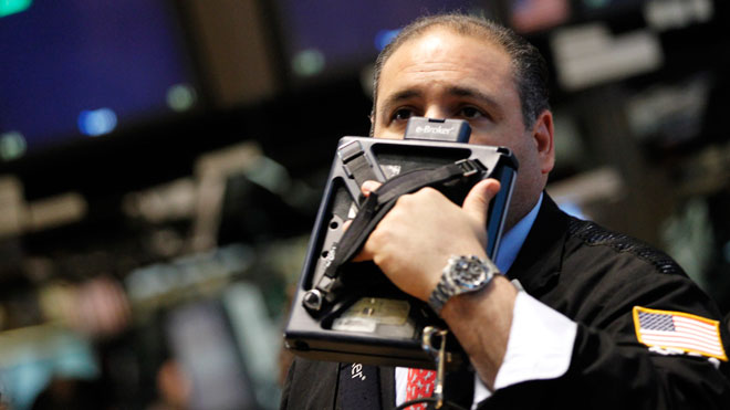 NYSE Trader Holds Tablet to Face (Worried)