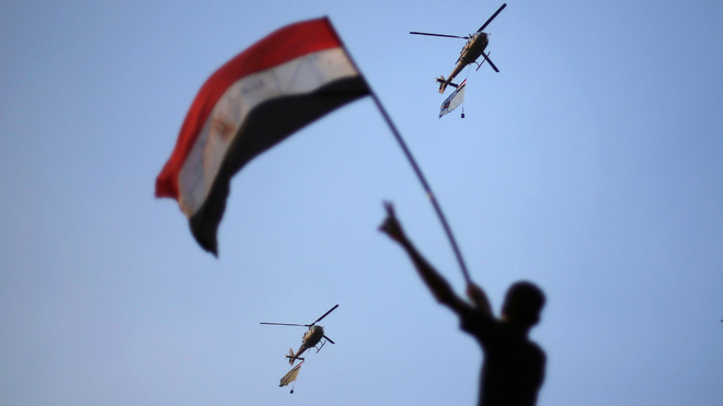 Protester Waves Flag at Army in Cairo, Egypt