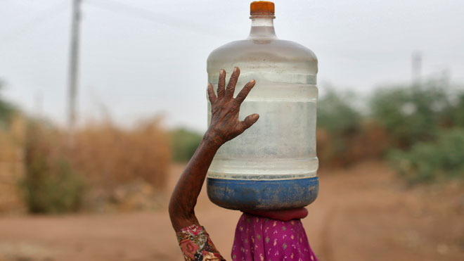 Drinking Water, village woman
